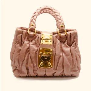 Miu Miu pink leather braided satchel